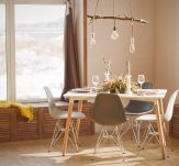 stylish dining room in neutral shades with big window