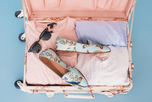 open pink suitcase