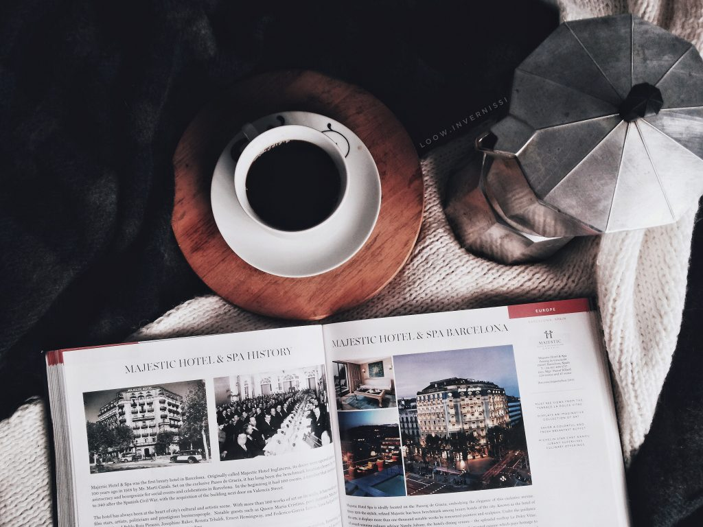 Coffee cup and travel catalogue