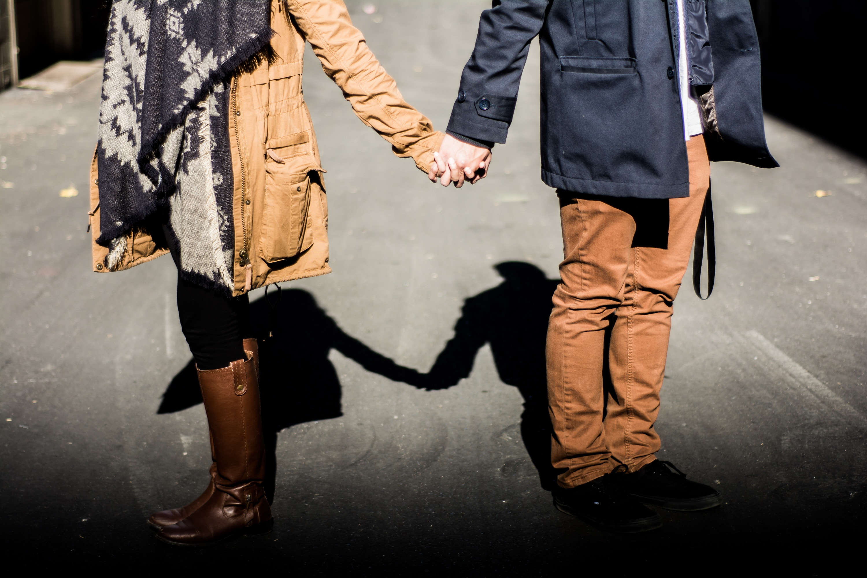 couple holding hands in winter coats