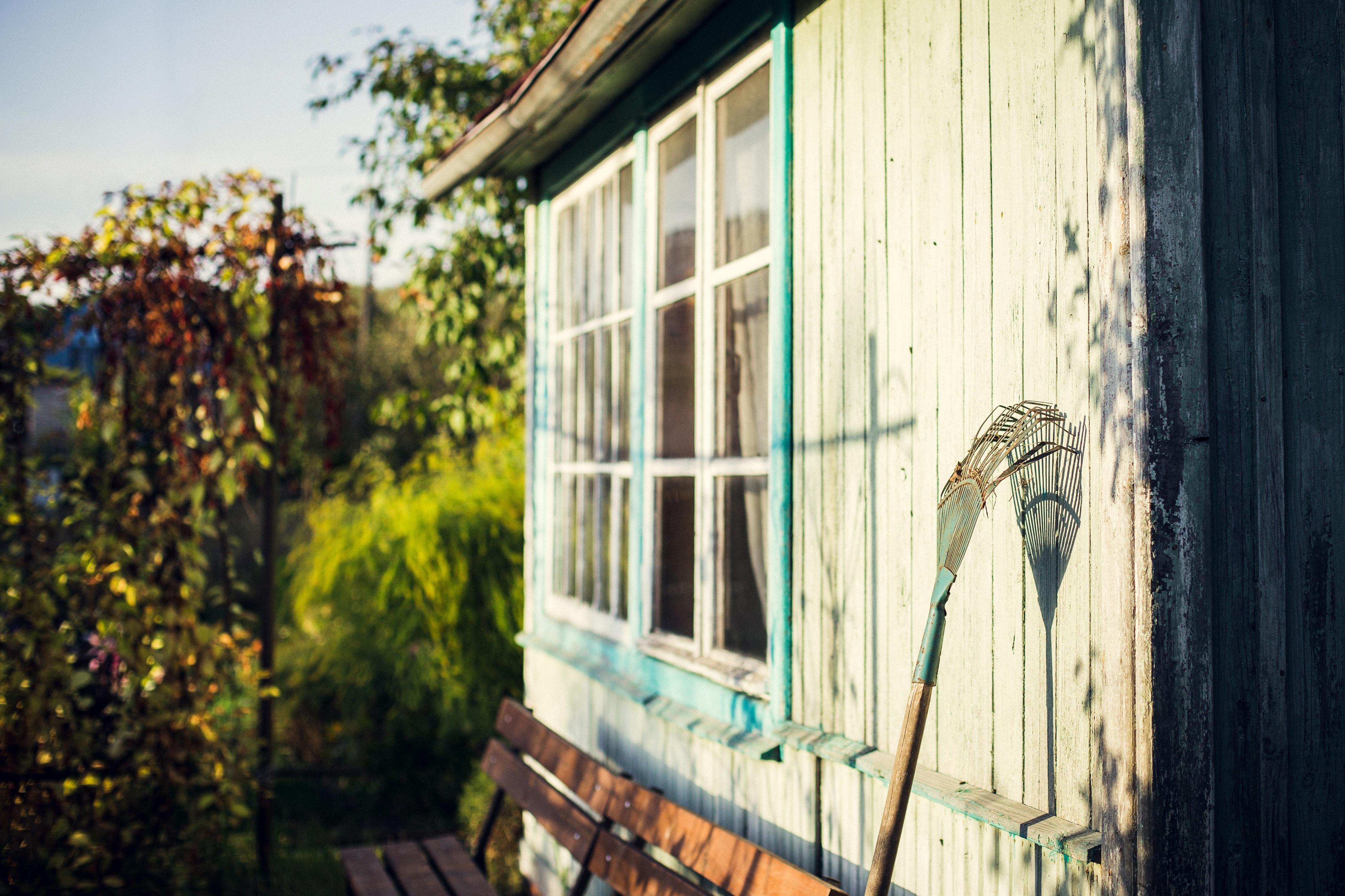 rake against shed