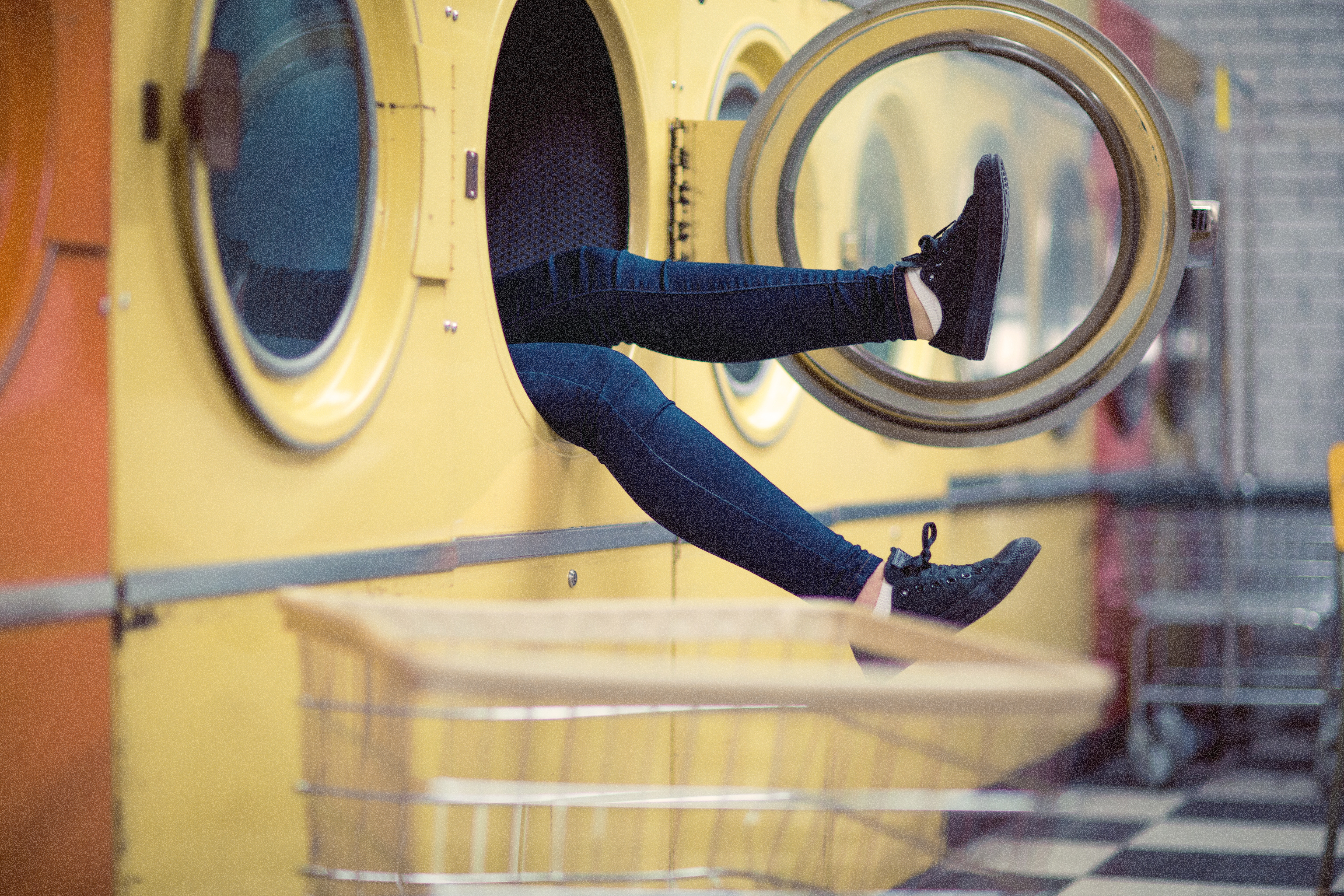 woman in machine at laundromat