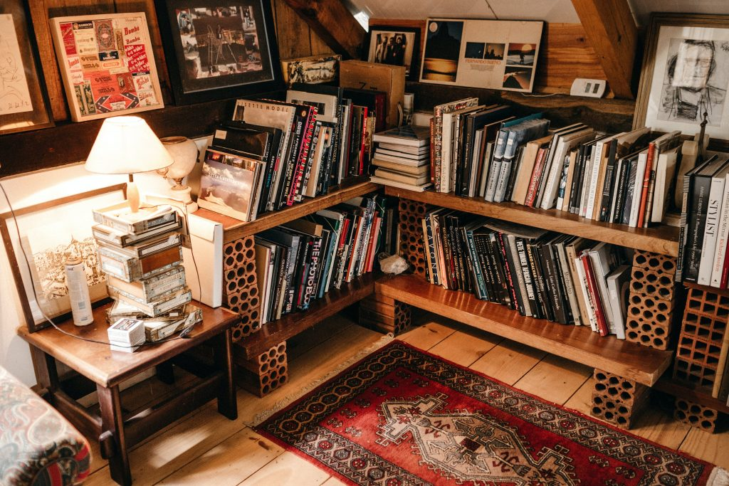 <alt text: Books, paintings and documents in a home library.>