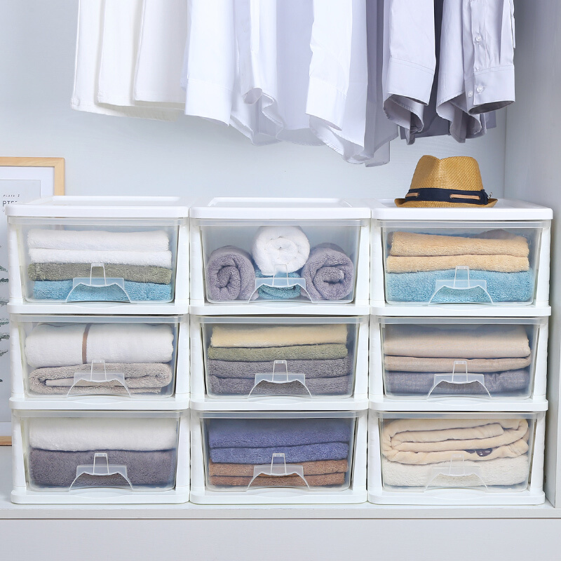 towels in storage boxes inside closet