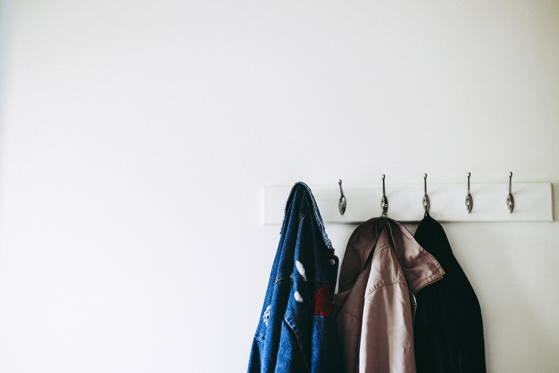 Three jackets on hooks