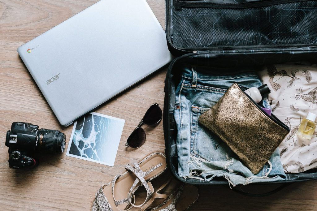 <luggage with laptop, camera, clothing and accessories>