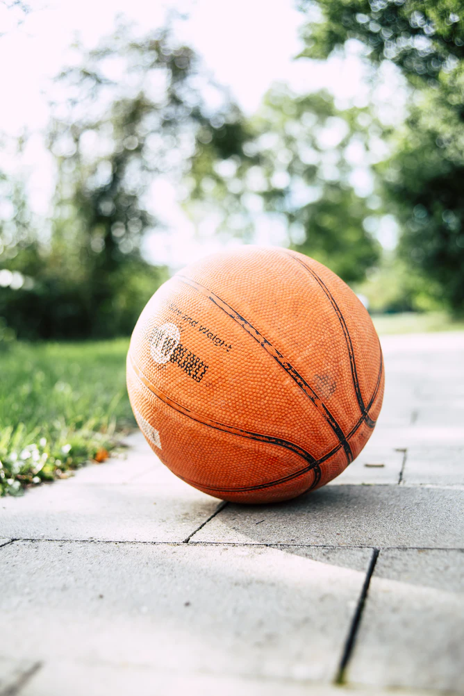 (alt-text: Basketball is kept out during season and put away in a sports storage unit in off season.)