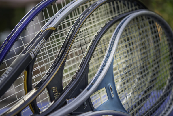 (alt-text: Storing sports equipment, like these tennis rackets, keeps sports gear in good condition while not in use.)
