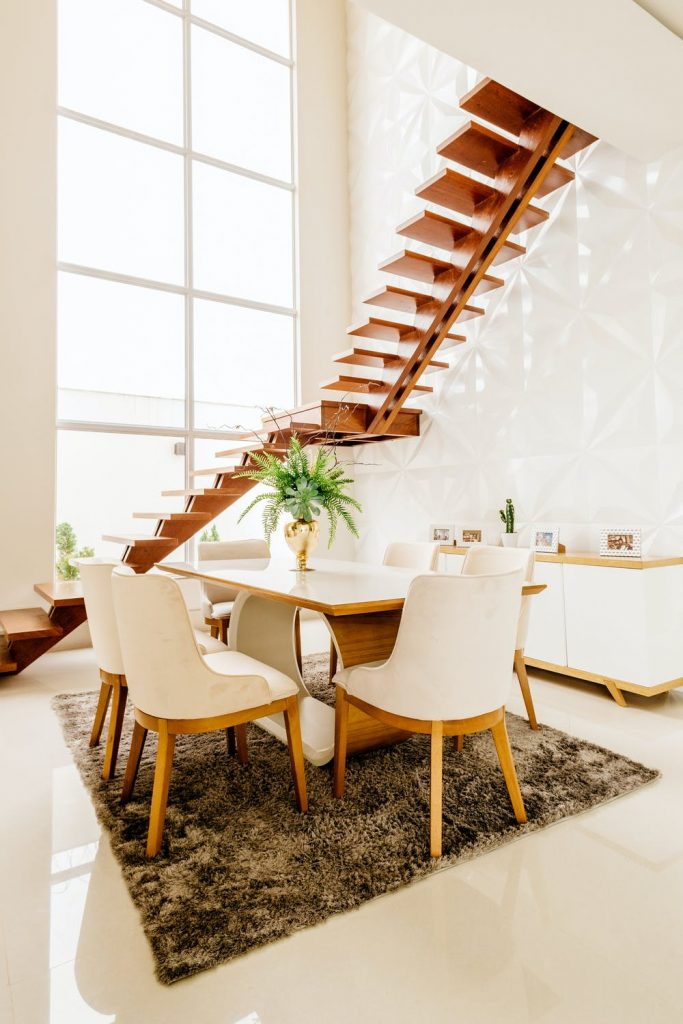 <alt text: A room with a consistent theme that flows through all its elements like stairs, furniture and other furnishings.>